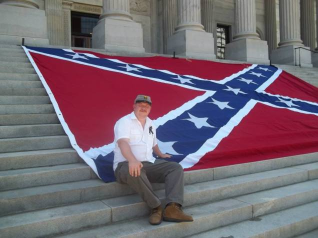 Roden Sits on Confederate Flag